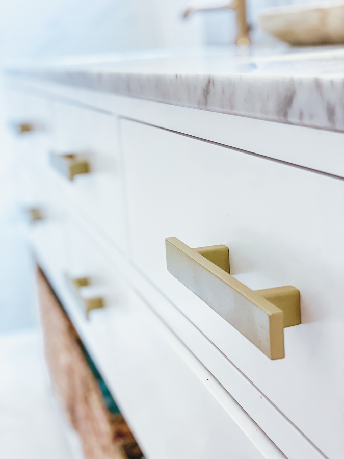 30A Mama Beachy Bathroom Renovation - marble vanity with gold handles
