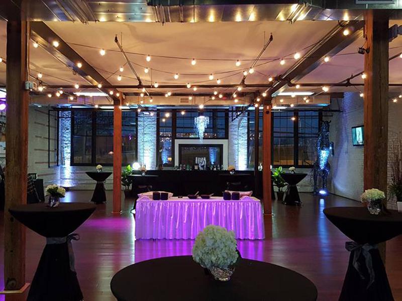 loft venue lit up for a wedding reception