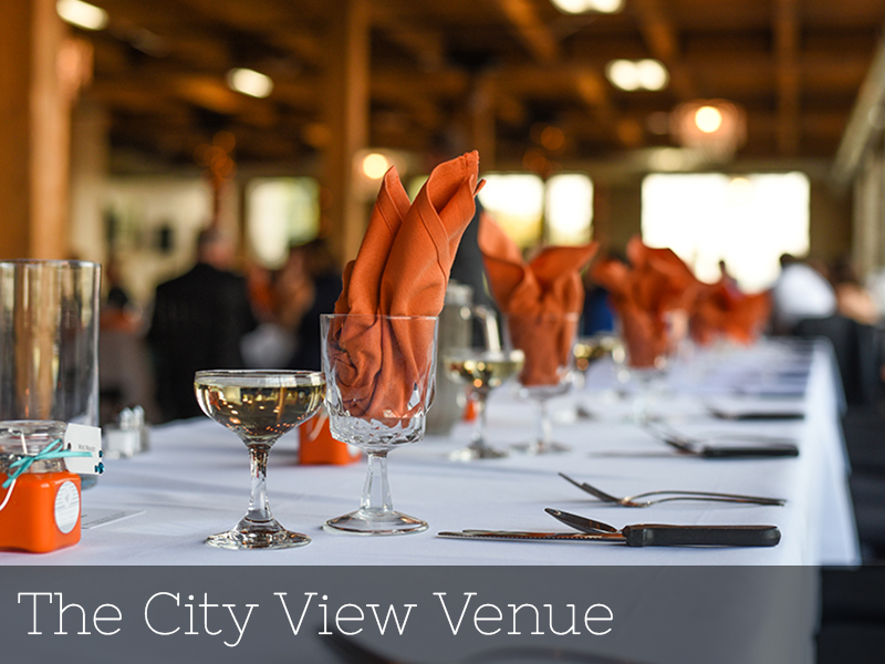 A photo of a beautiful tablescape with orange accents at a wedding reception