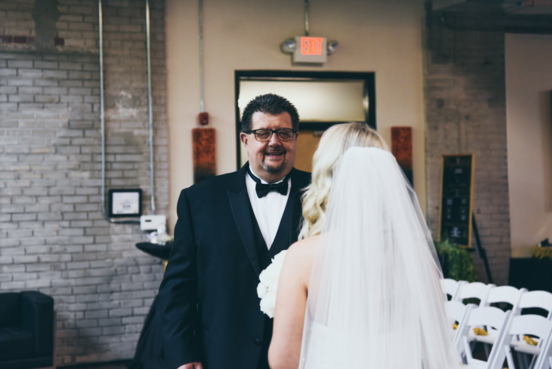 father seeing daughter for the first time in her wedding dress