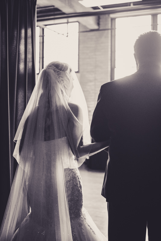 black and white image of bride and father getting ready to walk down the aisle
