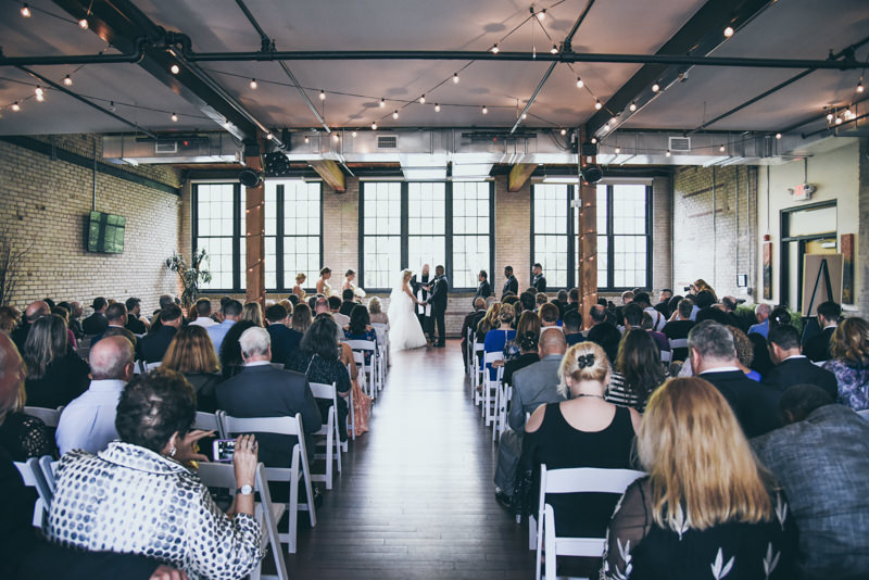 Wide angle view of loft venue wedding ceremony