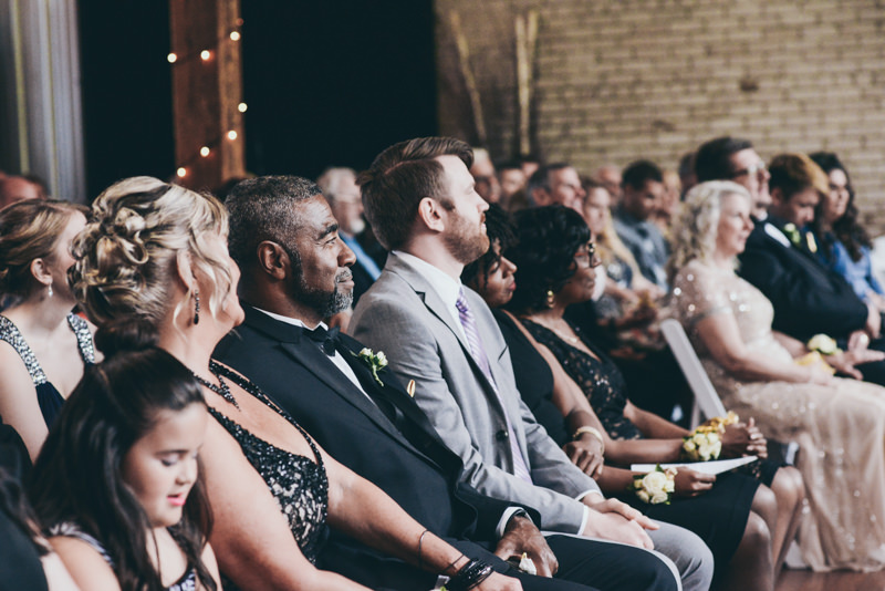 Parents in the front row at a wedding ceremony