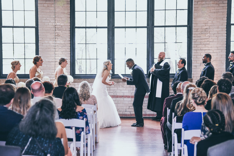 bride and groom doubled over in laughter while saying vows