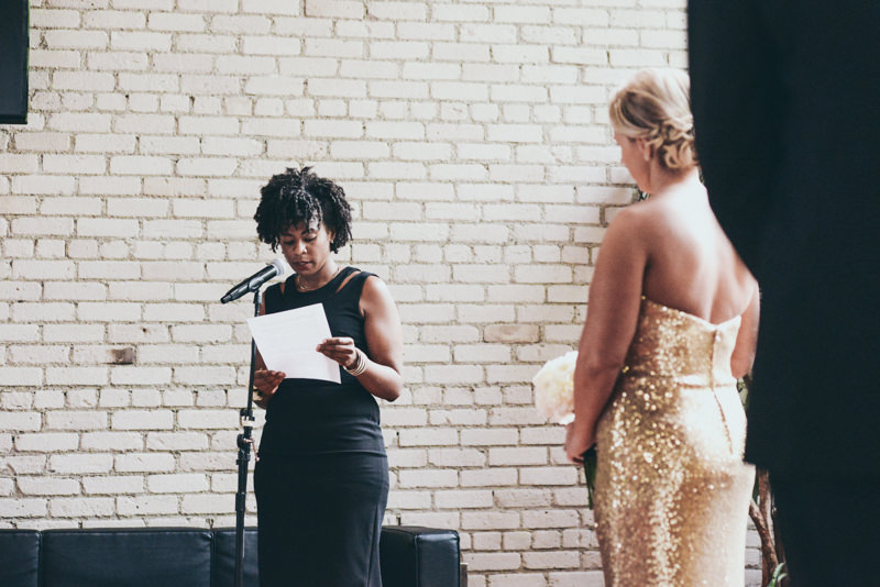woman reading a poem during a wedding ceremony