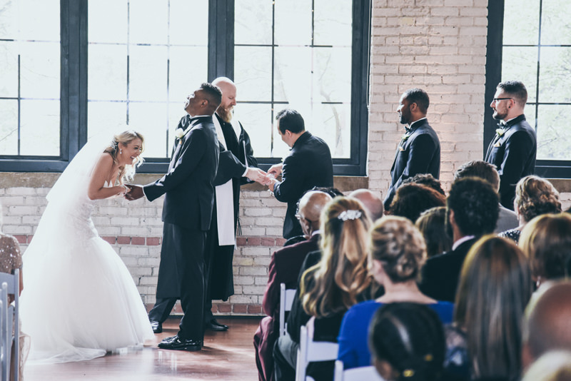 everyone laughing as best man cannot get rings out of pocket