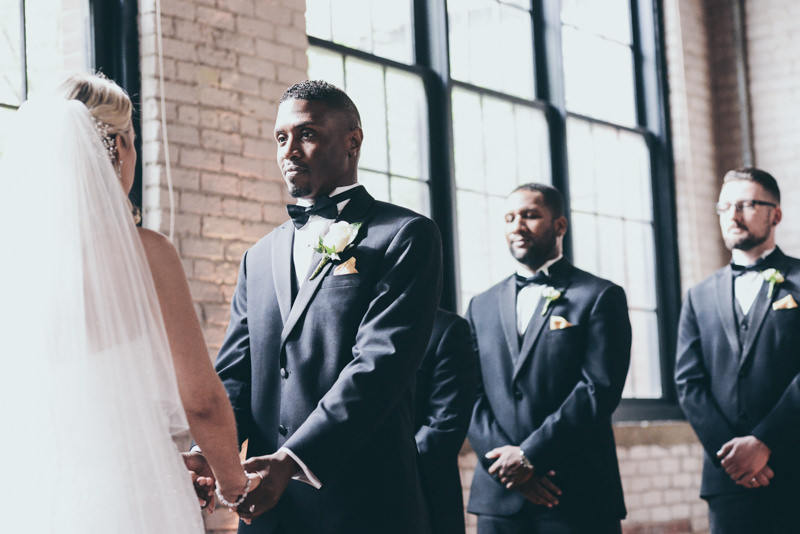 close up of grooms face during vows
