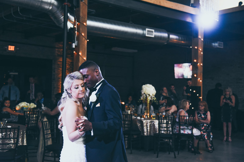 bride and groom first dance in industrial loft venue