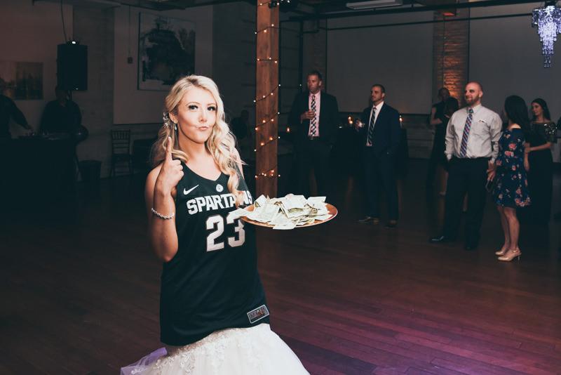U of M and MSU wedding reception game