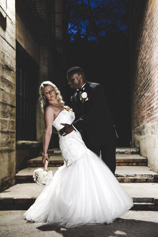 bride and groom night time photo in a dark alleyway