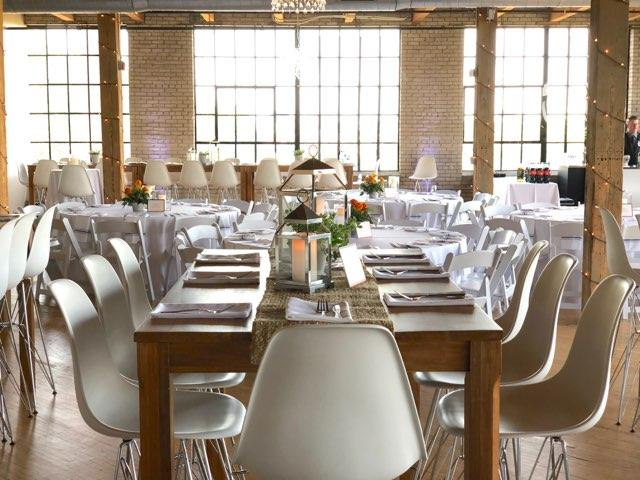 corporate event tablescape with farm tables, burlap and white herman miller chairs