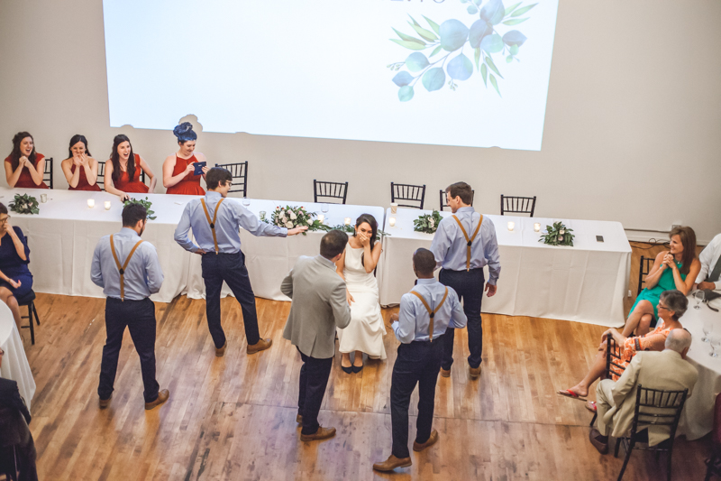 groomsmen surprising bride with a choreographed dance