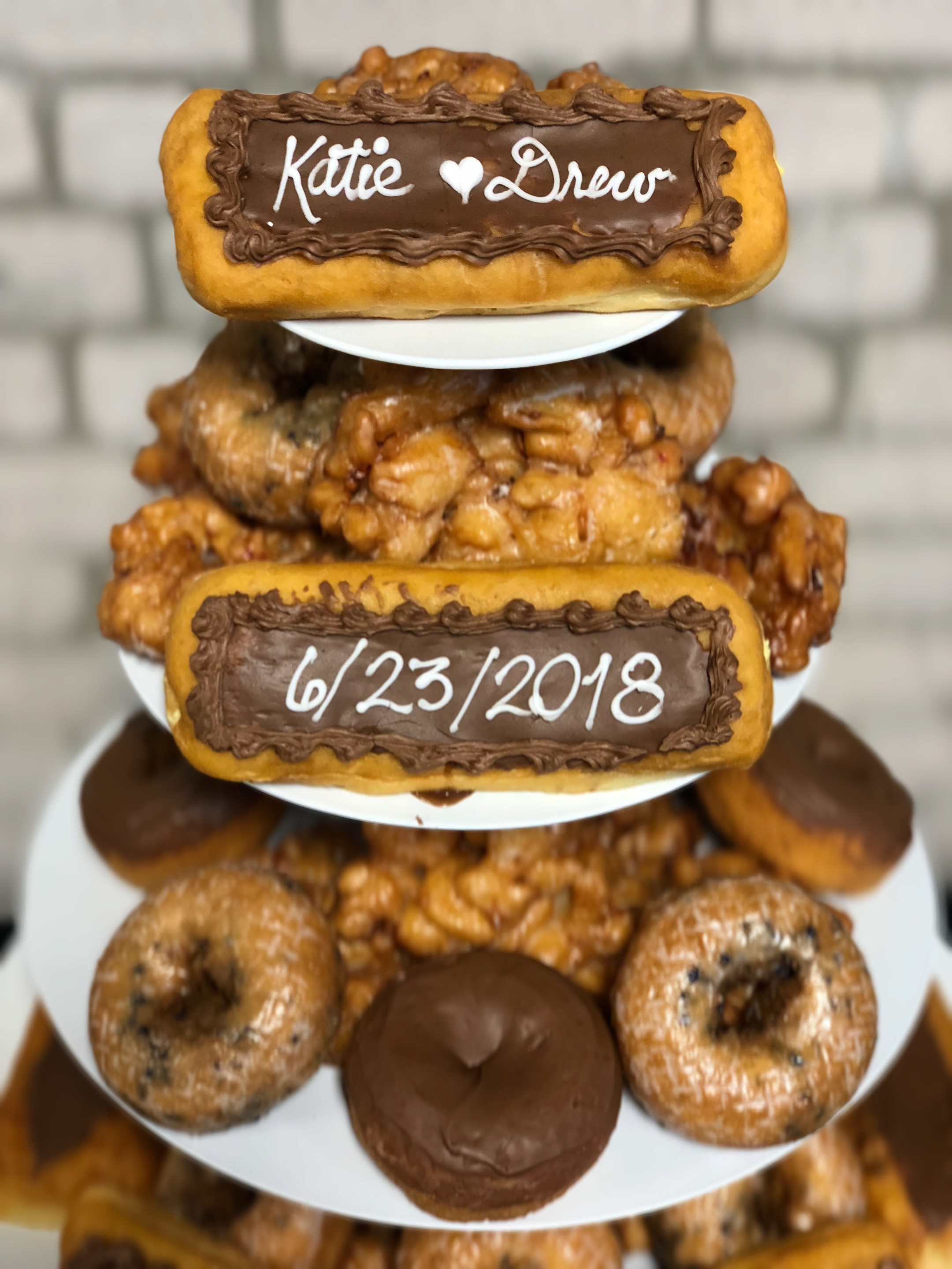 personalized long john donuts on a donut bar at a wedding reception