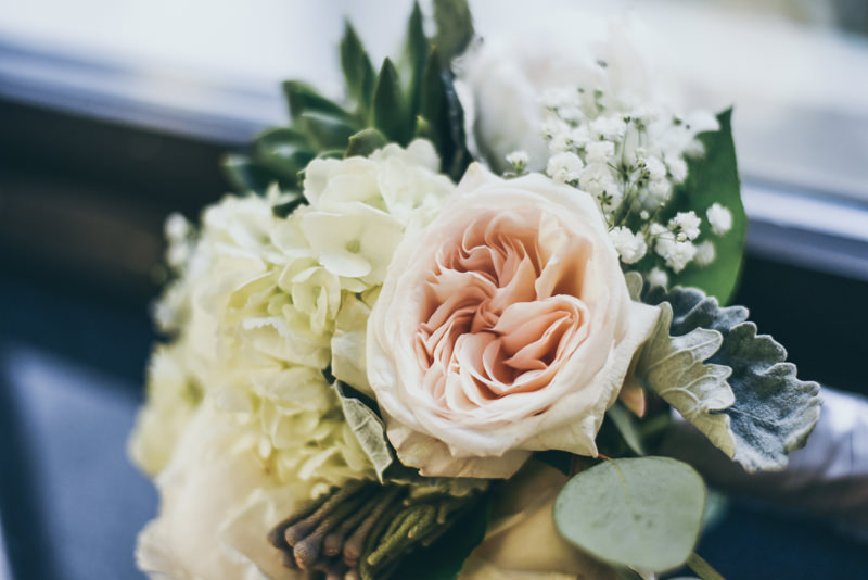 wedding bouquet with blush english roses, succulents, white hydrangea, and baby's breath