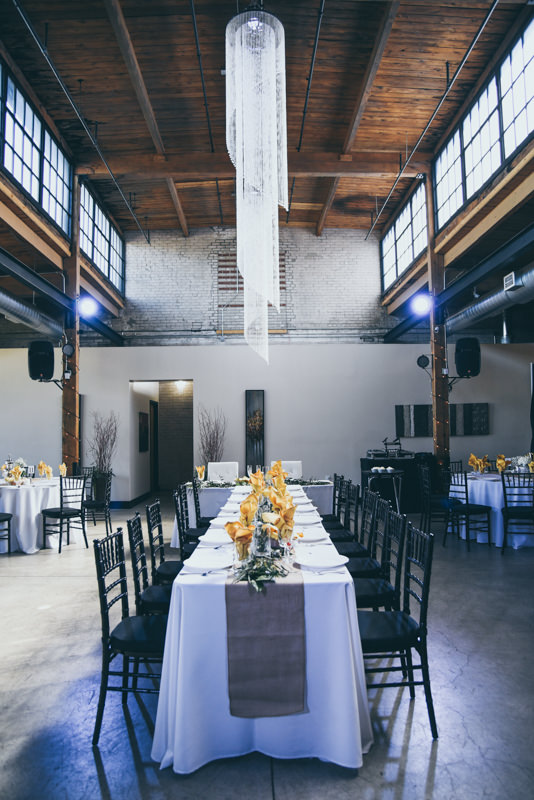 Loft Wedding Venue set up for reception with gold accents