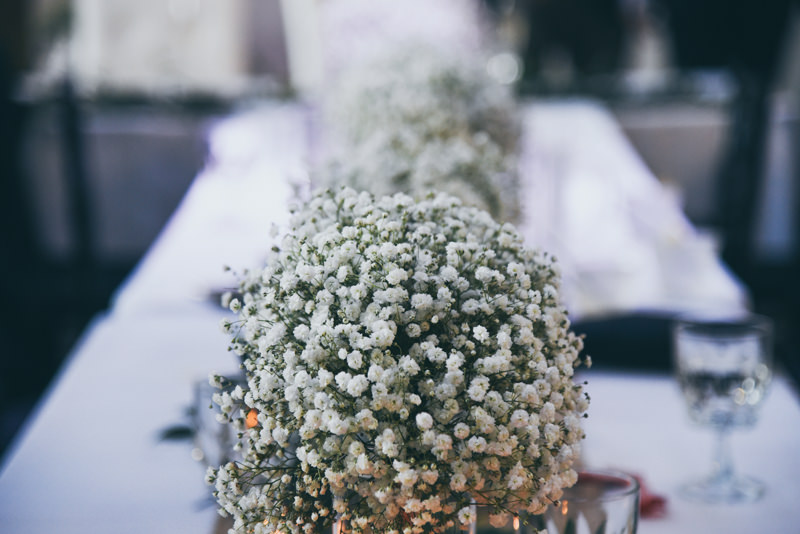 baby's breath at head table during wedding reception
