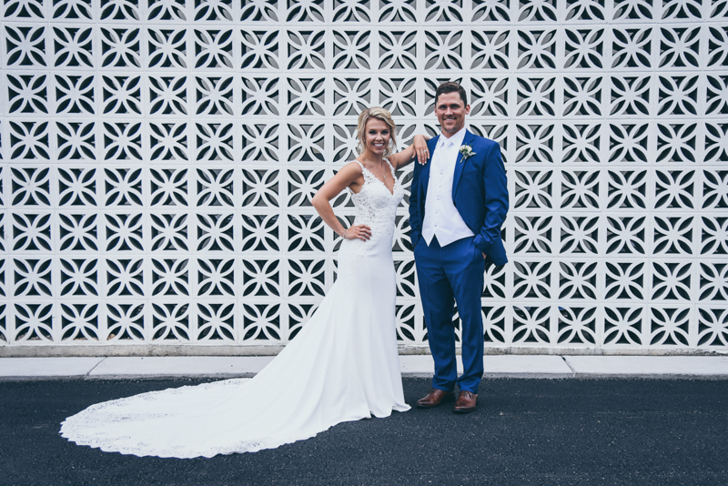 Bride and groom in front of a geometric brick wall in grand rapids michigan