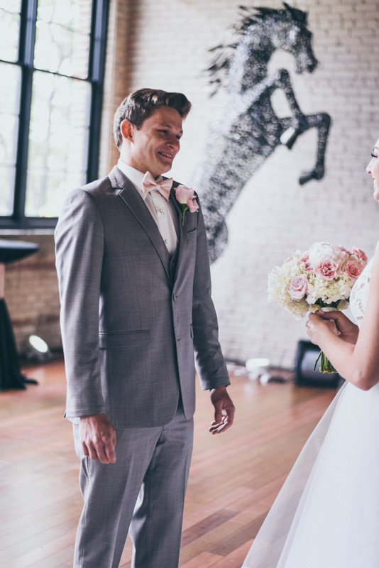 groom turns to bride during first look