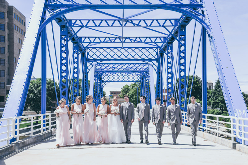 bridal party in pink and gray on the blue bridge in grand rapids mi