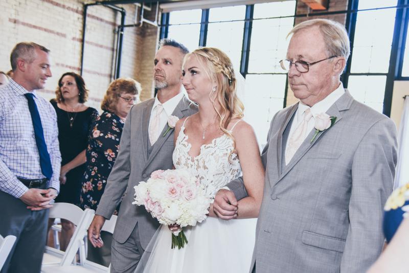 a dad and grandpa walking a bride down the aisle