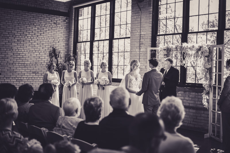 black and white image of a bride and groom at the altar at their wedding ceremony