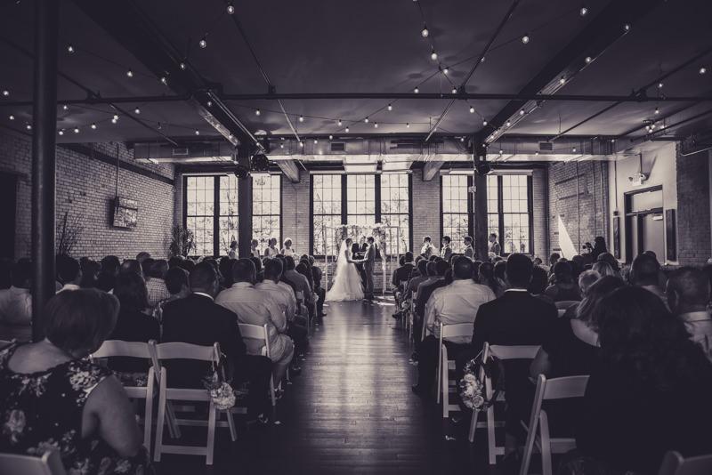 black and white image of a loft wedding venue ceremony