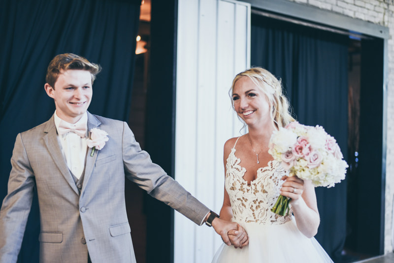 bride and groom grand entrance at wedding reception