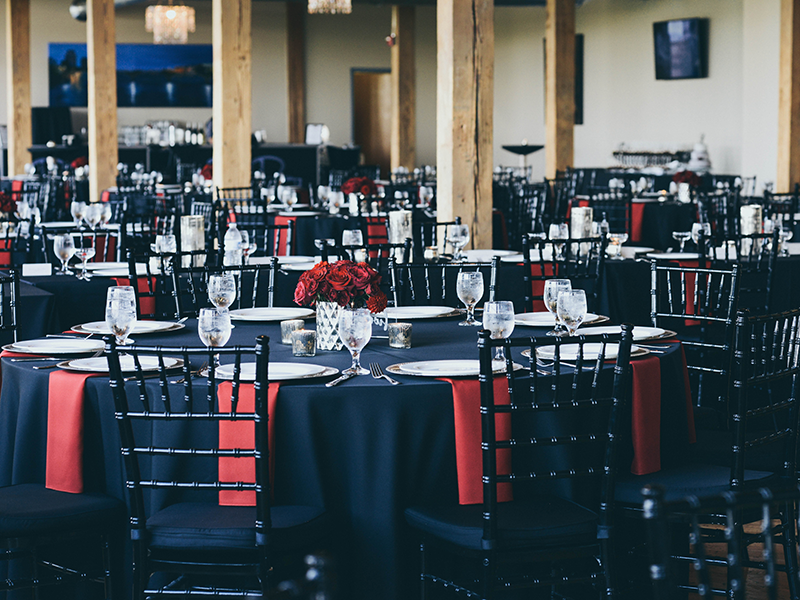 black and red tablescapes in a city view venue