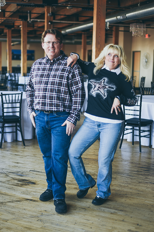 Dan and Andrea Deward goofing around in their city view venue