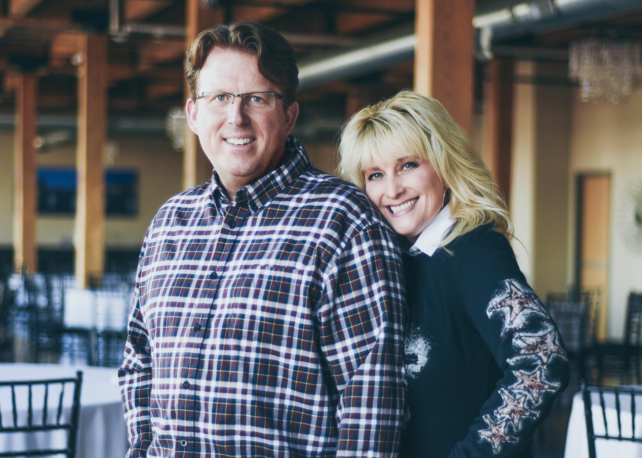 Dan and Andrea Deward in a casual pose in their loft wedding venue