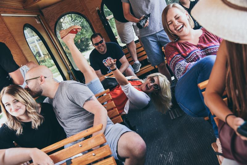 group having fun on an open air trolley