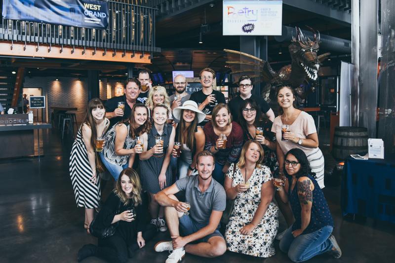 team photo inside a brewing company