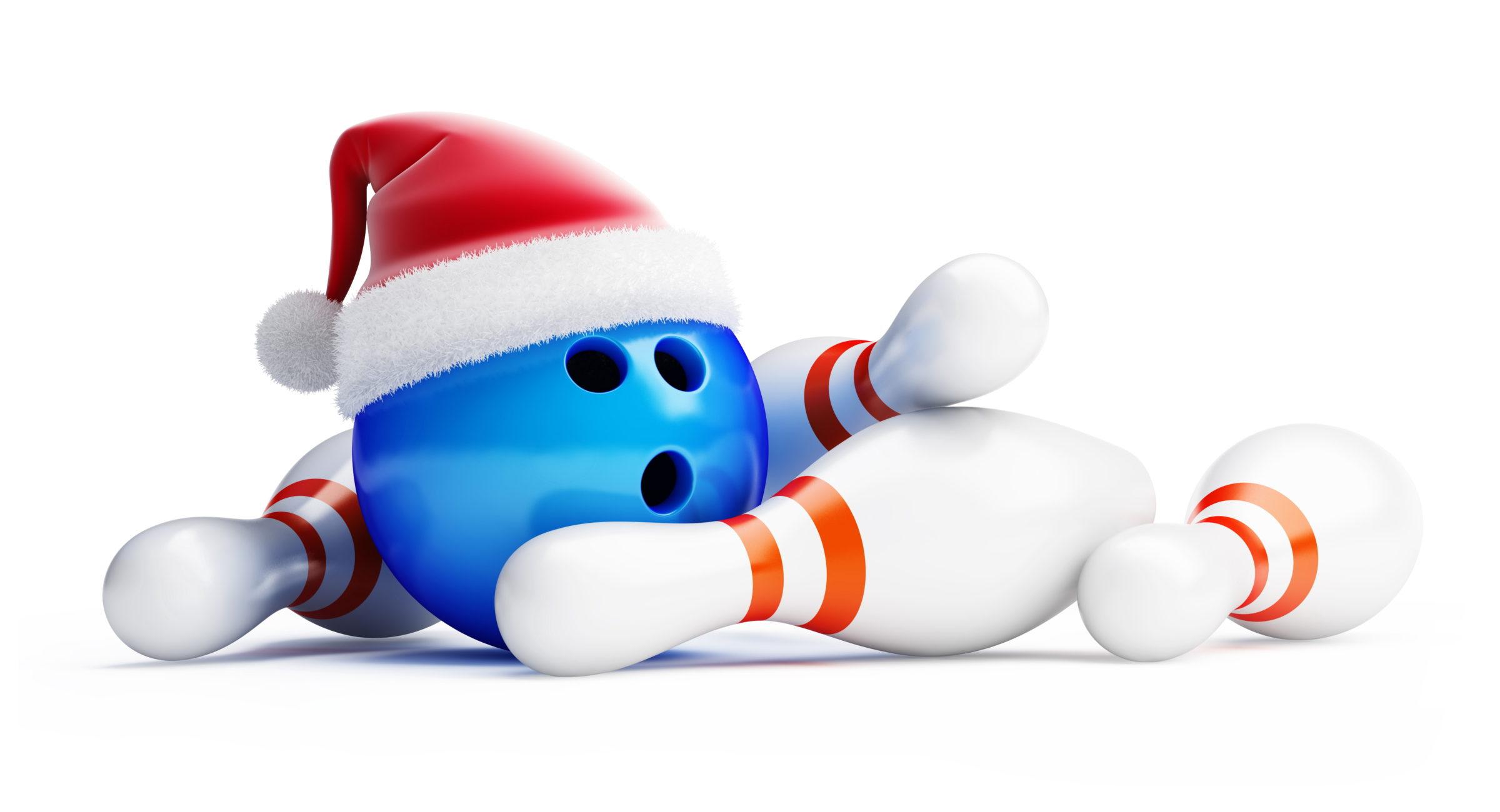 Bowling pins and bowling ball wearing a santa hat