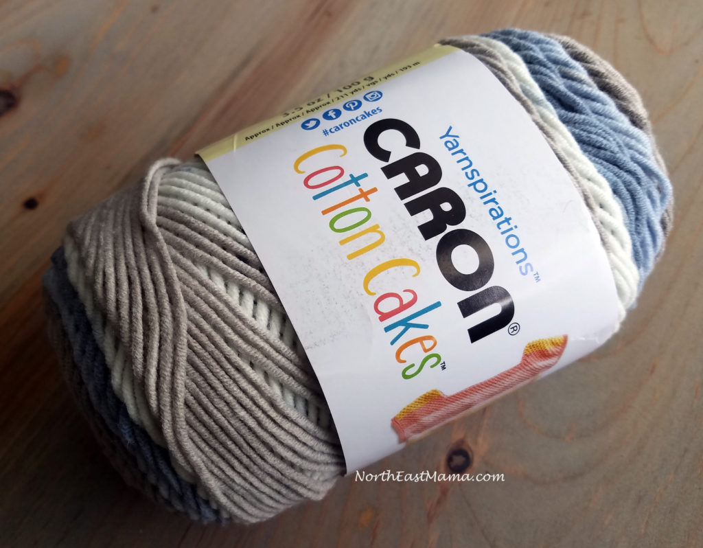 Image of 1 skein of Caron Cotton Cakes in Nested Blues on a wood table