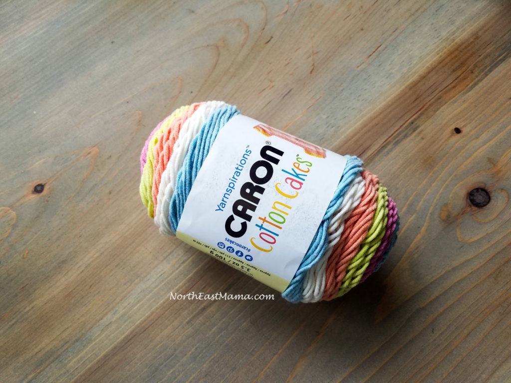 Image of 1 skein of Caron Cotton Cakes in Garden Oasis on a wood table
