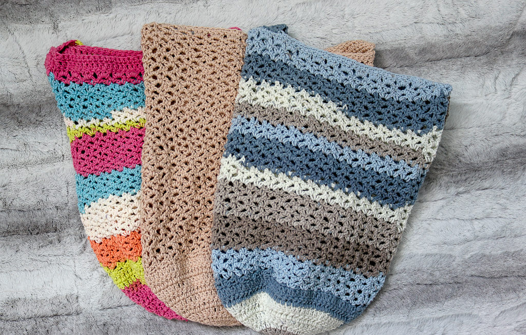 Three Crochet Totes displayed on a flat lay.