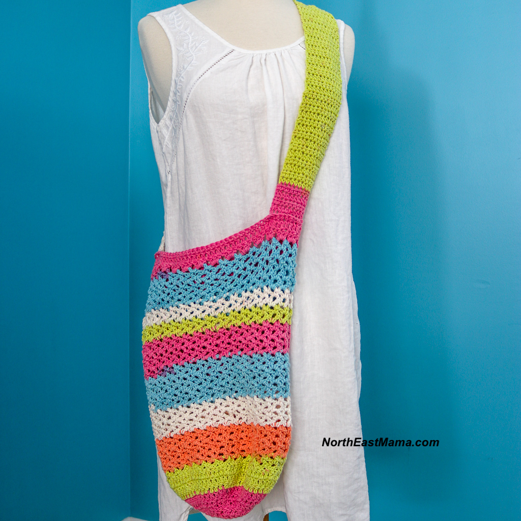 Crochet tote displayed on a mannequin