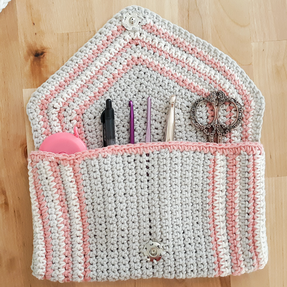 chic crochet clutch shown with crochet accessories,
