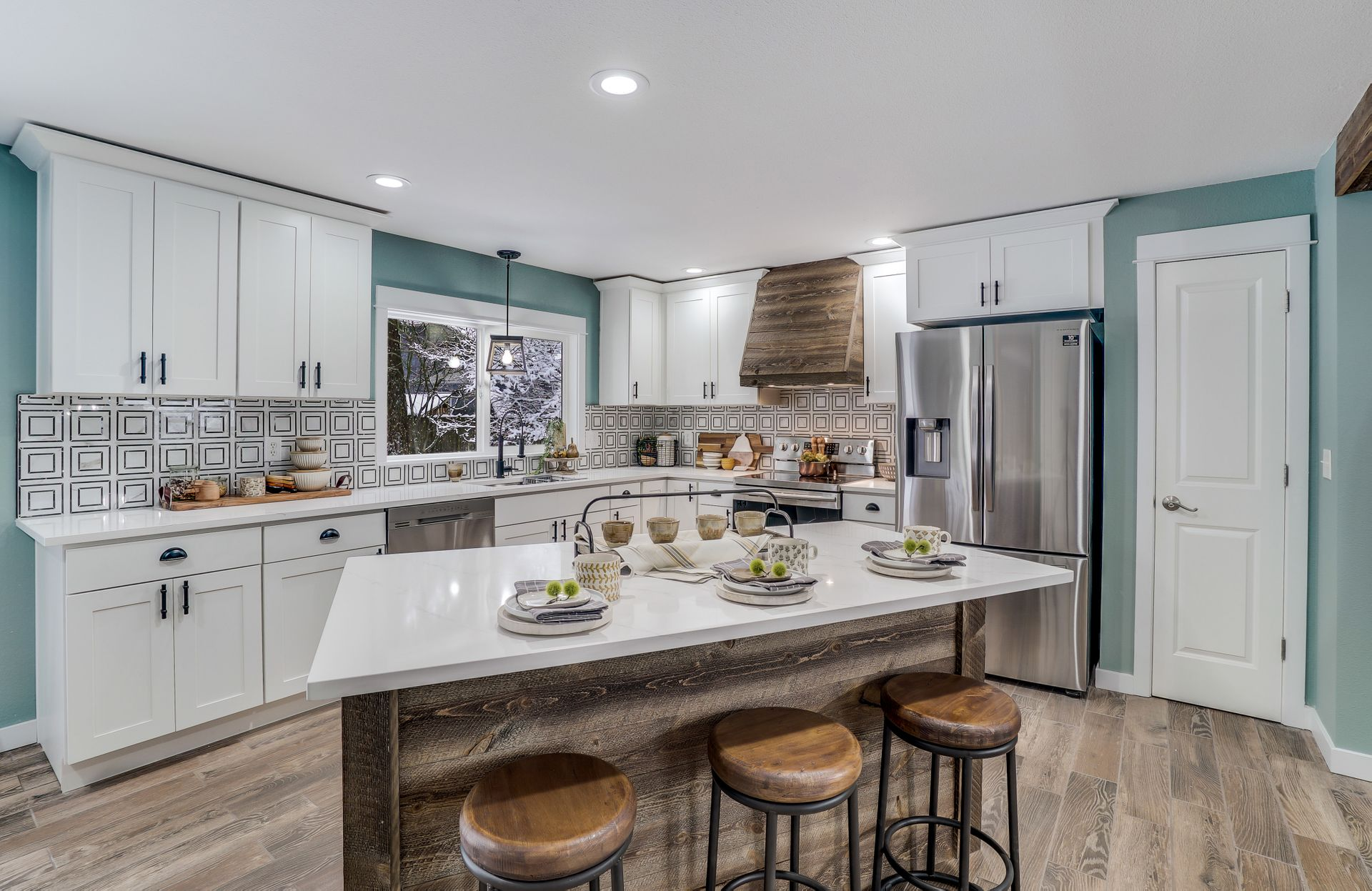 A contemporary farmstyle kitchen design from JL Remodeling
