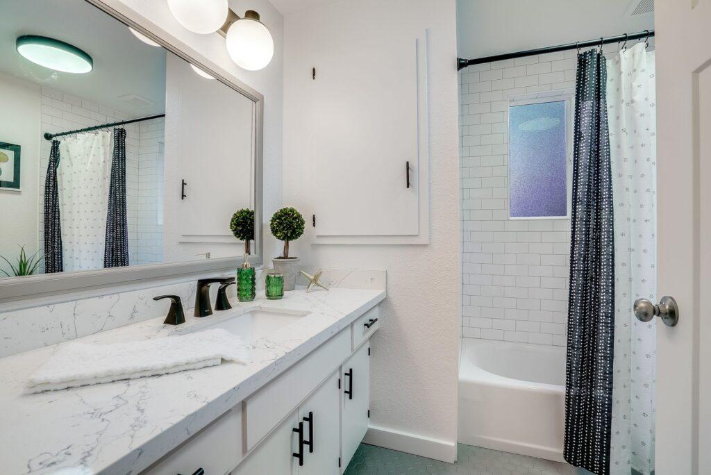 Green subway tile kitchen backsplash installed by professional tilers.