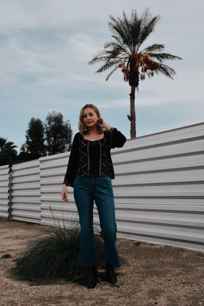Girl in front of a wall in Palm Springs, California