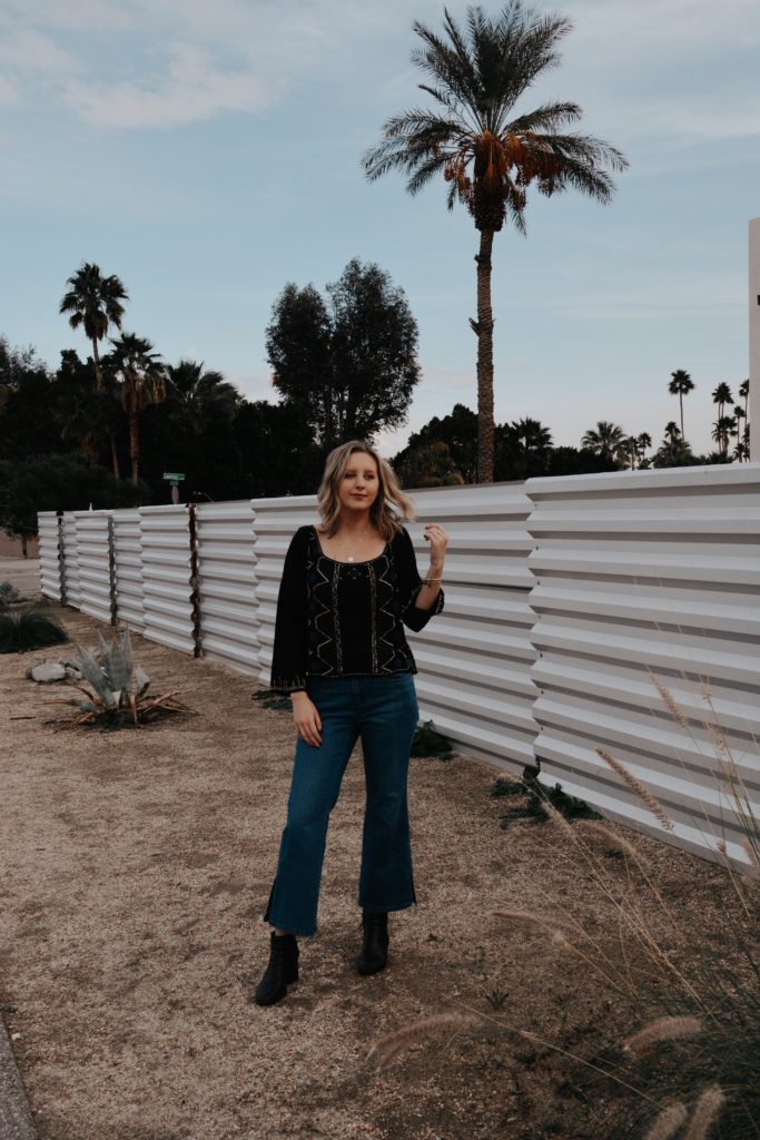 Woman modeling a California Winter Outfit in Palm Springs.