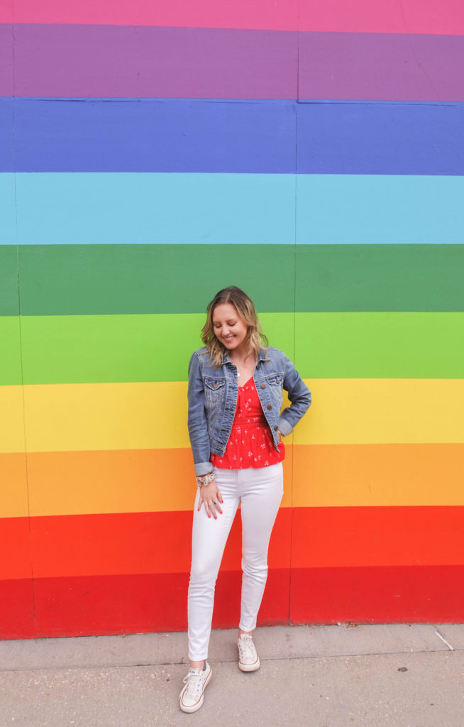 Woman in white jeans in front of a Rainbow Wall Mural in Chicago, IL