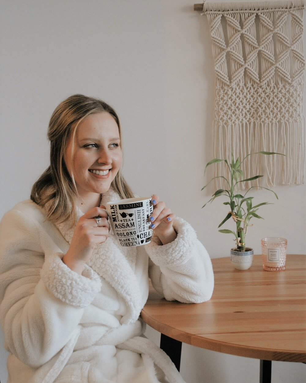 Blonde Woman Enjoying a Homemade Matcha Latte in the Morning