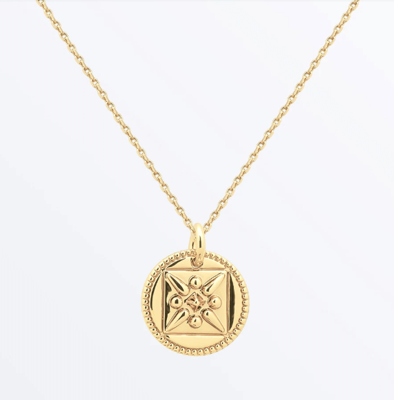 Gold Necklace with a Circular Pendant, little accessories can boost your mood