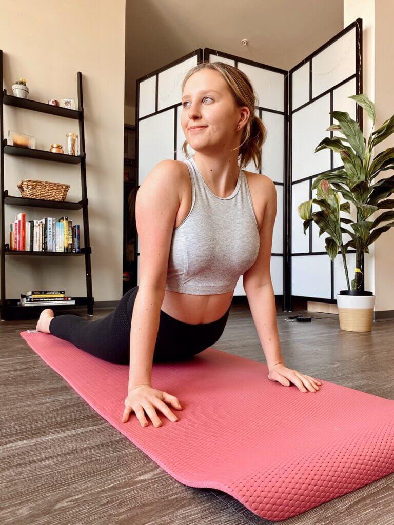 Young Woman Striking a Yoga Pose