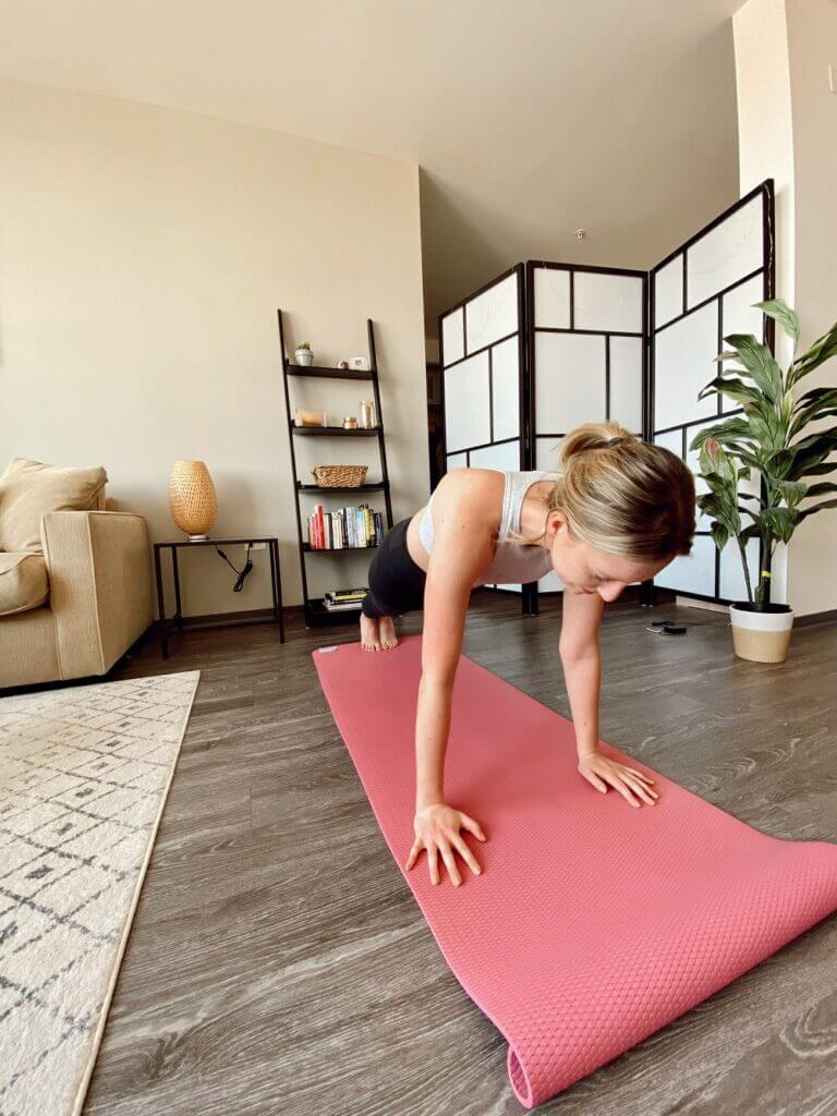 Blonde Woman Practicing Yoga in Her Living Room