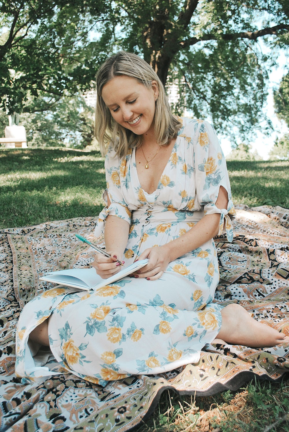Young woman journaling in a park