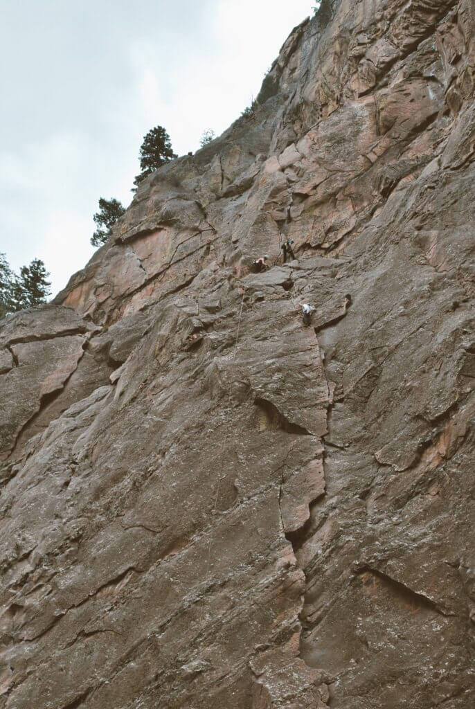Rock climbers scaling the wall at Eldorado Canyon, a state park in Colorado