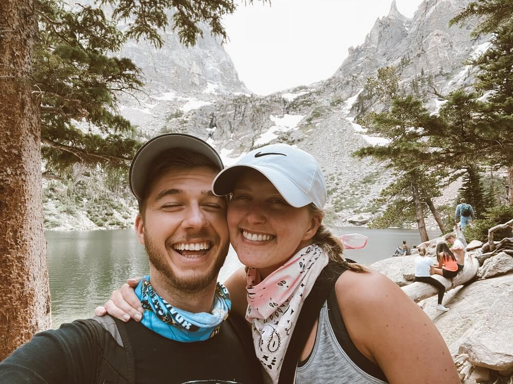 Smiling in front of Emerald Lake at Rocky Mountain National Park in Colorado